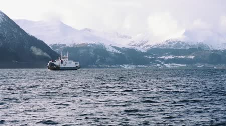 Ferry on the fjord time lapse with snow mountains, near volda (norway) Stock mozgókép