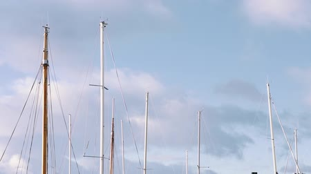 Ship masts with clouds in background Vídeos