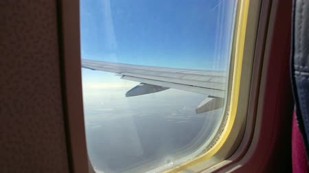 Airplane wing with clear sky
