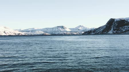 Snow mountains with fjord near Tromso, Norway