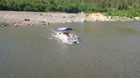 Aerial view of motor boat ride on lake Wideo