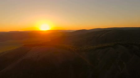 Aerial View. Flying over the hills at sunset. Wideo