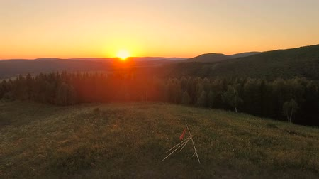 Aerial View. Flying over the hills at sunset. Stock Footage