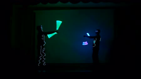 gimmick : Men twist fiery circles on a LED show.