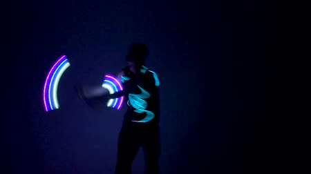 gimmick : Man twists fiery circles on a light show. Stock Footage