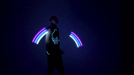 gimmick : Man twist fiery figures on a light show. Stock Footage