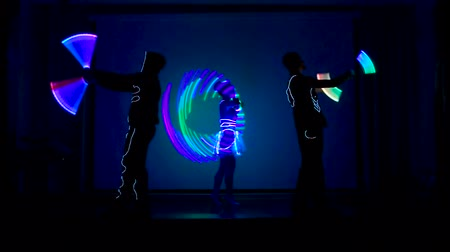 gimmick : Two men and a woman performes light show.