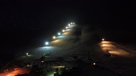 floodlight : Night flight to the slope of the ski resort. Stock Footage