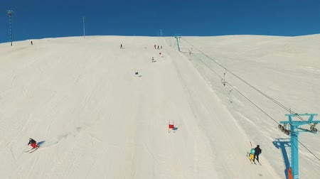 outdoor hobby : Skier rides dounhill on track.