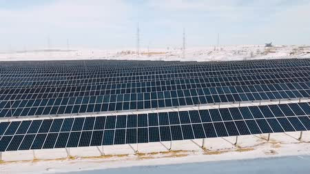 solar power : aerial solar farm low flight in winter