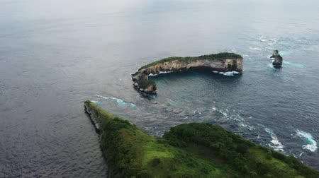 Suitable spot for surfing top view from drone on magnificent cliff on sea coast covered with greenery and vegetation asian landscape from above of ocean with turquoise clear water great place to relax