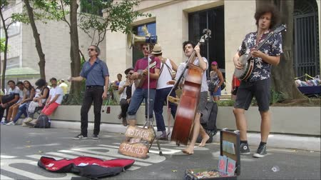 SAO PAULO, BRAZIL January 15, 2016: Unidentified group of street musicians playing at the famous Paulista Avenue on Sunday, when this street is traditionally closed for cars and free for pedestrian