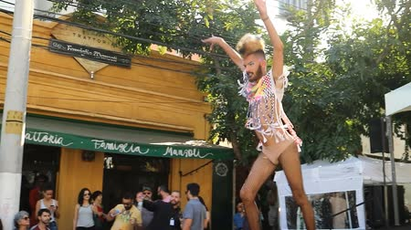 Sao Paulo, Brazil December 9, 2018: Unidentified man dancing in a public and cultural street event in Sao Paulo Brazil. Performing modern and sensual dance. Стоковые видеозаписи