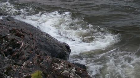Gale-Force Winds over Inland Lake, Waves Crashing into Rock