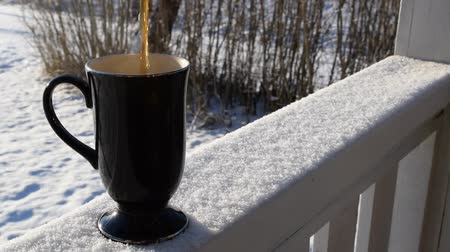 Pouring Coffe in Cup on White Reeling, Snow-Covered