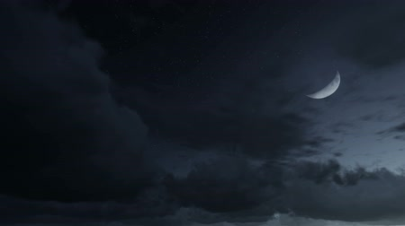starlit : Half moon rising through the clouds. Time lapse.