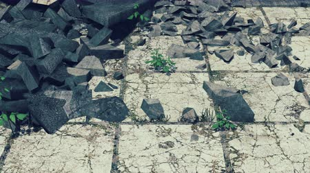 распад : Old cracked pavement with construction debris on it closeup Стоковые видеозаписи