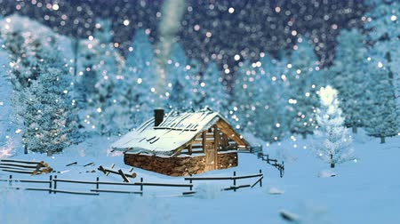 mese : Cozy little hut in mountains at snowfall night. Background is out of focus Stock mozgókép
