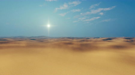 evening sun : Motion through barren lands of sandy african desert at sultry day with haze and sun disk on horizon Stock Footage