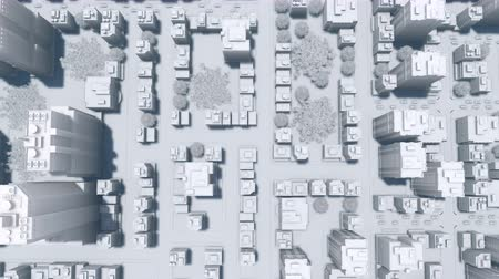architektonický : Abstract big modern city looking as white architectural scale model. Straight overhead aerial view. Simple 3D animation rendered in 4K