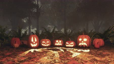 questão : Carved halloween pumpkins in misty night autumn forest