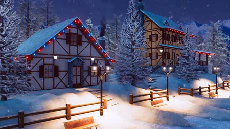 half timbered houses : Alpine mountain village at night with snowfall