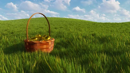 wiklina : Basket with colored easter eggs among green grass
