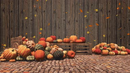 Various pumpkins for sale and falling autumn leaves on wooden background with place for text