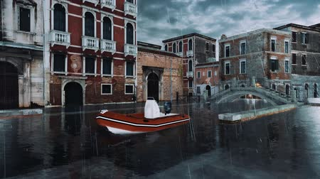 Empty flooded venetian street with ancient bridge over canal and inflatable boat on foreground during High Water flood Acqua Alta in Venice at rainy dusk