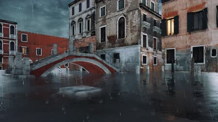 submerso : Empty venetian street with flooded sidewalks, ancient buildings and bridge over water canal during catastrophic flood Acqua Alta in Venice at rainy evening