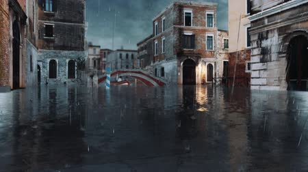submerso : Empty venetian street with flooded ancient buildings and sidewalks during catastrophic High Water flood Acqua Alta in Venice, Italy at heavy rain