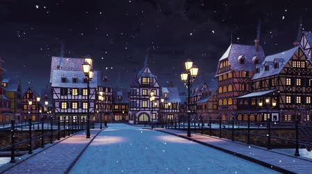 new town : Cozy medieval town with traditional half-timbered european houses and empty road over the bridge lit by street lights at calm winter night during snowfall Stock Footage