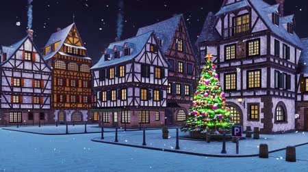 half timbered houses : Empty european town with illuminated outdoor christmas tree on its square and traditional half-timbered houses at snowfall winter night