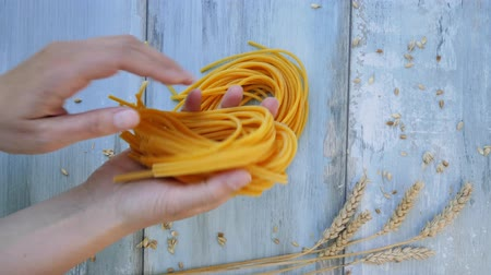 spagetti : Preparing delicious fresh pasta on blue wooden vintage table. Culinary pasta eating.