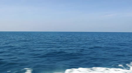 Blue ocean, sky and splashes from boat. Sabbatical, journey and travel. Stok Video