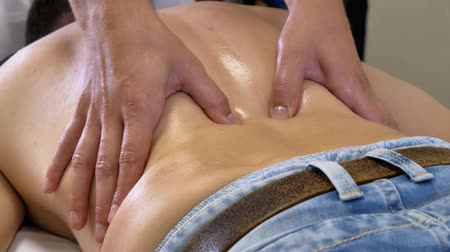Deep Tissue Massage. Medical massage. Masseur massaging man back. Stok Video