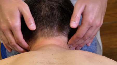 Masseur massaging mans neck. Neck Pain.