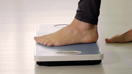 Standing on two digital scales. Physiotherapy weight balance diagnose.