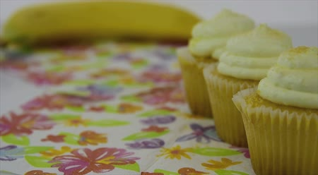 Healthy food options.  Starts focused on a yellow lemon creme cupcake, then transitions to a yellow banana