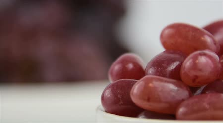Healthy food options.  Starts focused on a red jelly beans, then transitions to red grapes