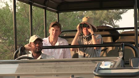 güney afrika : Young couple on game drive vehicle on safari in Botswana,Africa