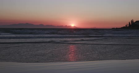 holiday makers : Sunrise over the a beach in Cape Town