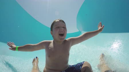 holiday makers : Happy young boy going down waterslide Cape Town