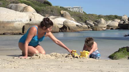 holiday makers : Mother and child playing on beach with toys,Boulders Beach,Cape Town,South Africa