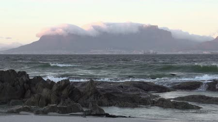 holiday makers : Zoom out of Table Mountain from across the sea with waves in the foreground, Cape Town,South Africa Stock Footage