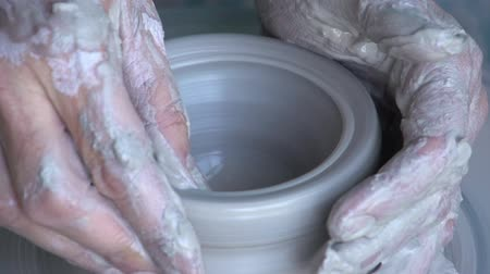 cape wheel : Woman throwing a pot on a potters wheel,Cape Town, South Africa Stock Footage