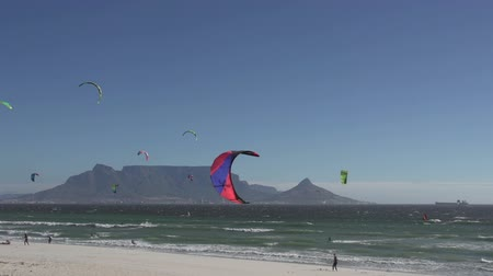 garden route : Windsurfers on the famous Bloubergstrand with Table Mountain in the background, Cape Town, South Africa