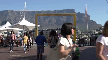holiday makers : Time-lapse of tourists posing in front of Table Mountain view point, Victoria and Alfred Waterfront, Cape Town,South Africa