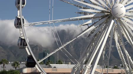 cape wheel : Zoom out of the Giant observation wheel at Victoria and Alfred Waterfront with Table Mountain in background,Cape Town,South Africa