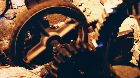 Old vintage gear wheels rotating with increasing speed
